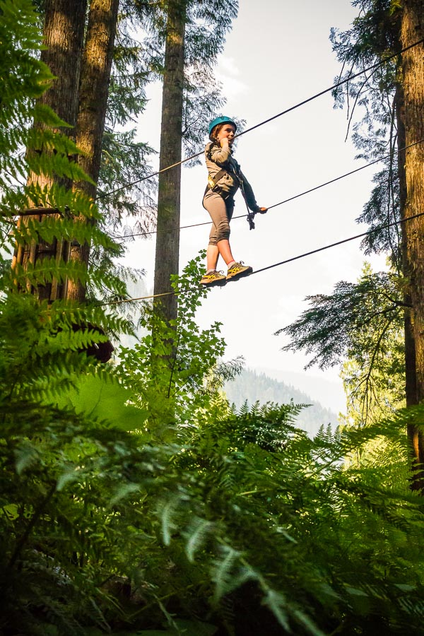 Crossing a monkey bridge on the Kids Tree Adventure course @ SkyTrek Adventure Park, BC