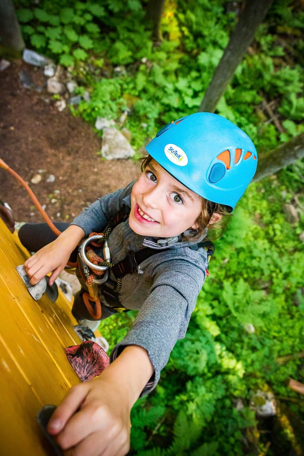 Climbing up the suspended wall on the Sky Course @ SkyTrek Adventure Park, BC
