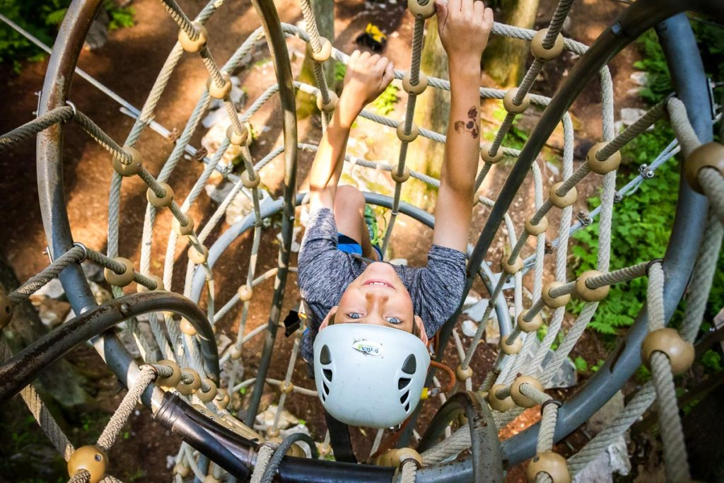"""Climbing up the inverted section of """"the noodle"""" on the Sky Course @ SkyTrek Adventure Park, BC"""