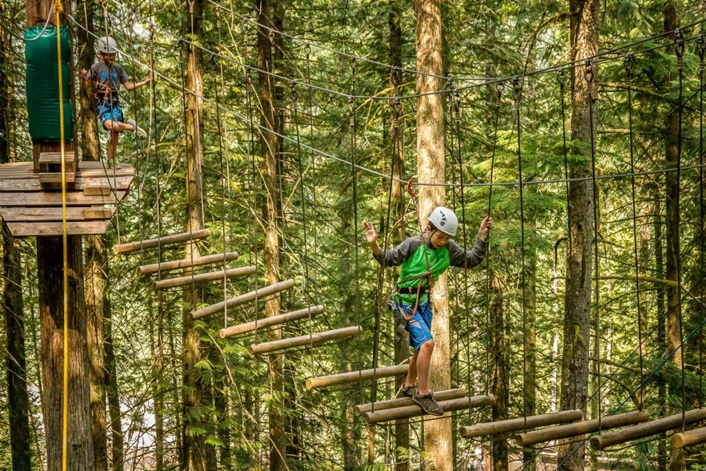 Crossing the swinging logs on the Sky Course @ SkyTrek Adventure Park, BC