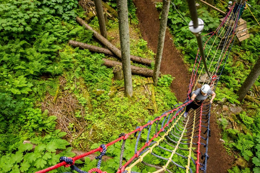 Climbing up the netted bridge on the Sky Course @ SkyTrek Adventure Park, BC