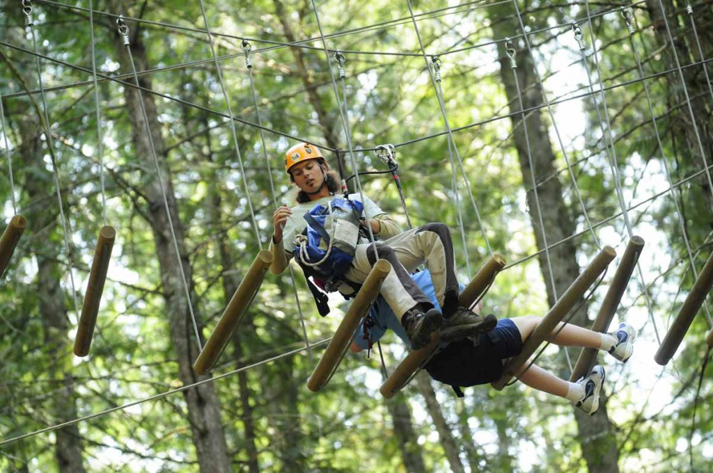 One of our Aerial Trekking Guides performing a rescue in the trees @ Skytrek Adventure Park, BC