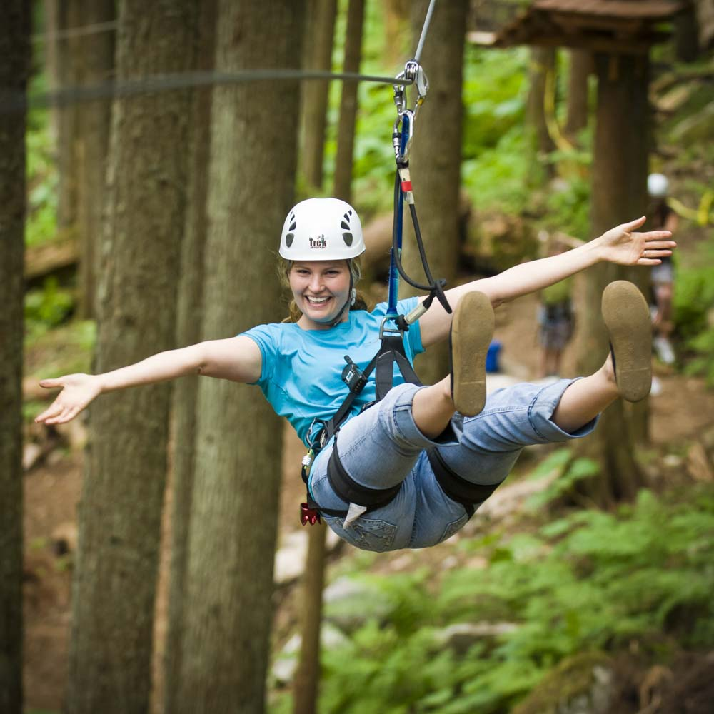 Flying through a zip line on the Sky Course @ SkyTrek Adventure Park, Revelstoke, BC