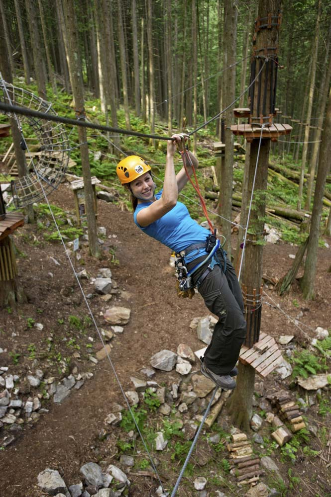 Crossing a monkey bridge on the Sky Course @ SkyTrek Adventure Park, BC