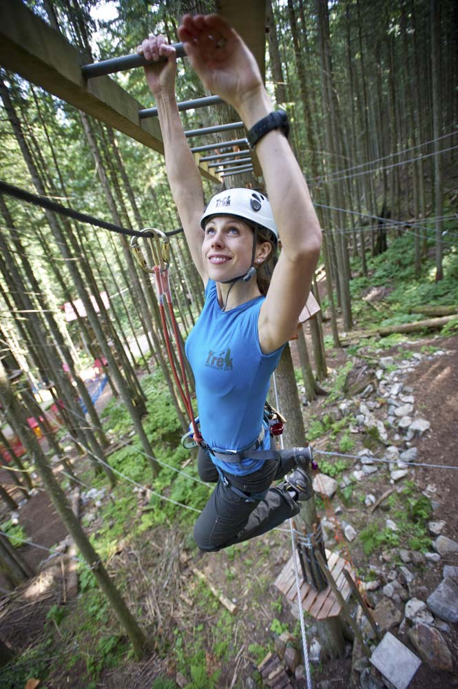 Crossing the monkey bars (no feet!) on the Sky Course @ SkyTrek Adventure Park, BC